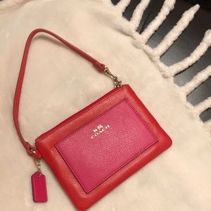 COACH orange and pink leather wristlet